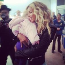Beyonce hugs baby at walmart