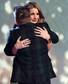 Hugging fellow contestant Nicholas